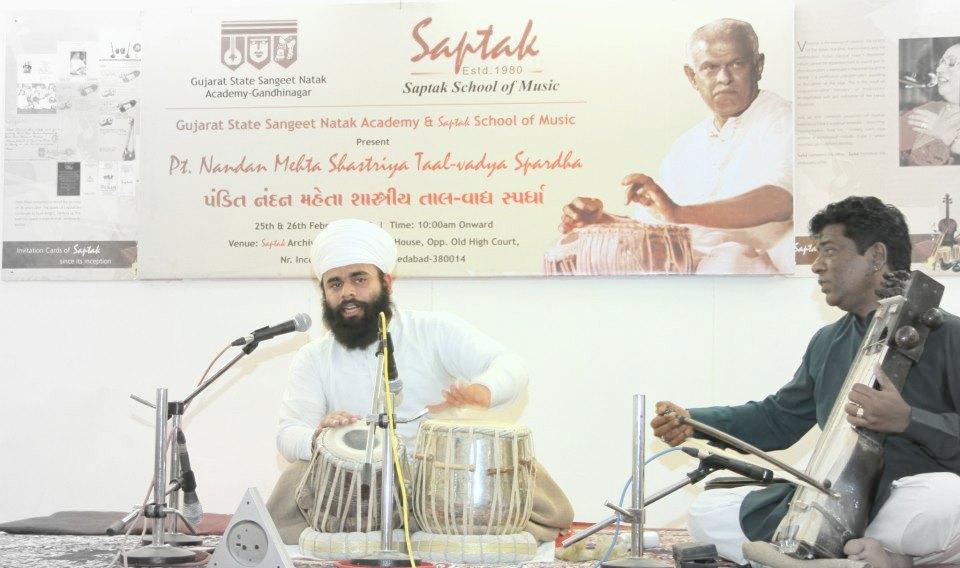 Performing Punjab Gharana Pakhawaj in sapatk school of music at Ahmedabad Gujarat with Shri Ikram Khan on sarangi lehra .