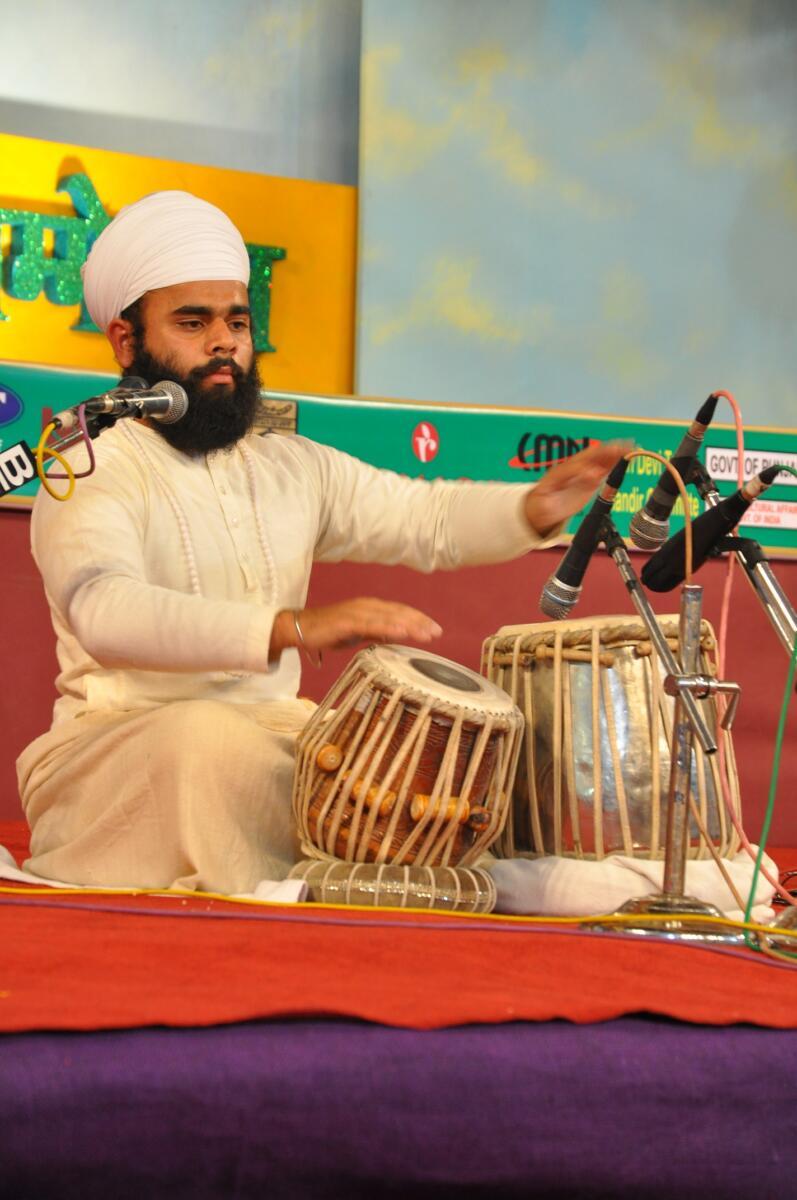 Rare sikh Instrument Jori representative Gian Singh Namdhari in harivallabh sangeet sammelan in 2011.