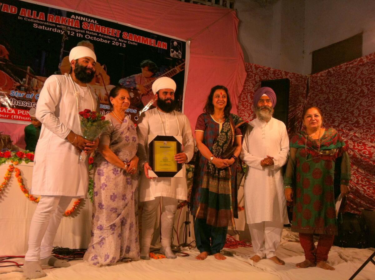 Ustad Kulwinder singh ji & Mrs. Purnima Beri honoured after the amazing Pakhawaj solo concert of ustad allah Rakha khan progran series in Hoshiarpur city Punjab .
